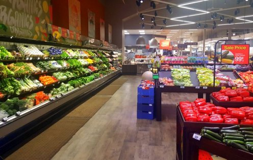 Darker floors, bright colors, and a dedicated organic section lend a more natural, earthy feel to the produce department.